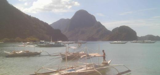 view of bangkas and islands in El Nido bay.