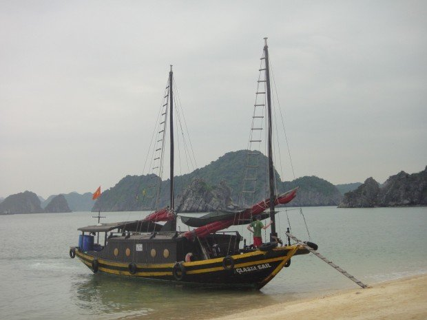 Junk moored on beach of Monkey Island, near Halong Bay, Vietnam