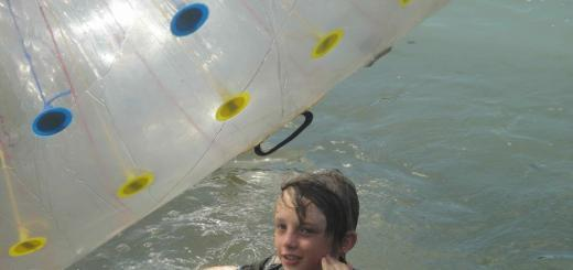 Z in lake with zorb (xorb) ball floating besides him. X-Centre, Chiang Mai, Thailand.