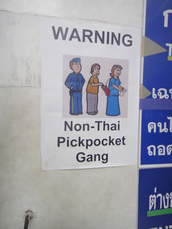 "Poster warning of ""non-Thai pickpockets"", Wat Pho, Bangkok"
