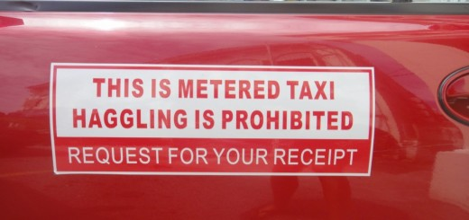 "taxi reading ""this is metered taxi. haggling is prohibited."""