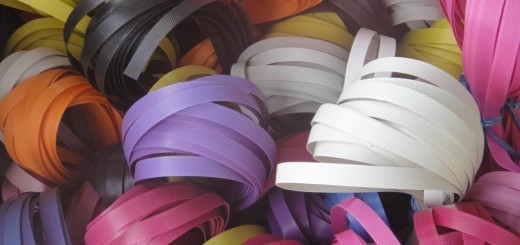 brightly coloured curls of packing tape.