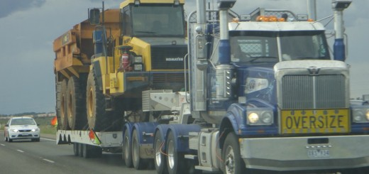 big truck carrying industrial machinery in outback australia