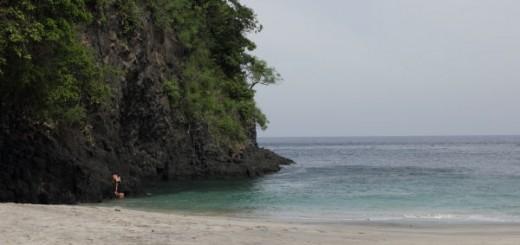 pantai putih, the white sand beach near bug-bug in bali, looking, frankly, greyish.