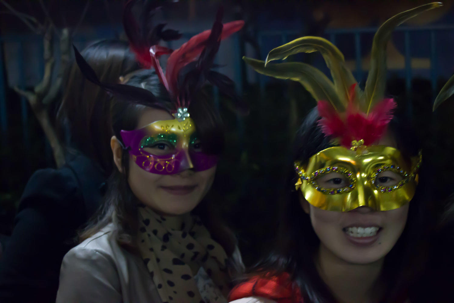 chinese girls in carnival masks for halloween