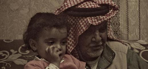 Little Bedouin girl with her great-grandfather in a village near Petra, Jordan.