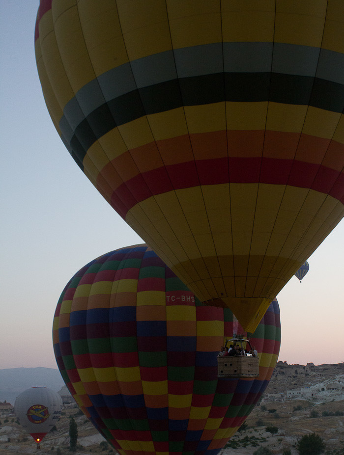 Two hot air balloons besides one another in Göreme, Cappadocia.