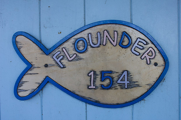 Flounder 154 sign on a beach hut in Wells, Norfolk.