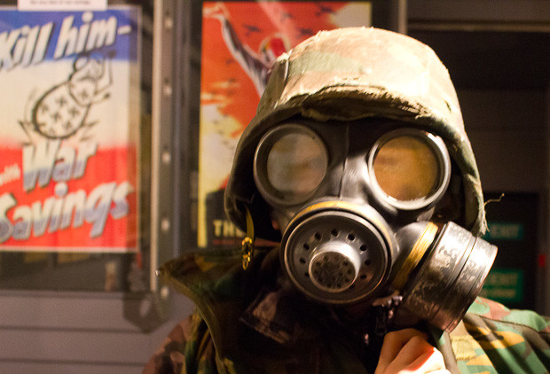 Trying on a gas mask at Winston Churchill's Britain At War Experience.