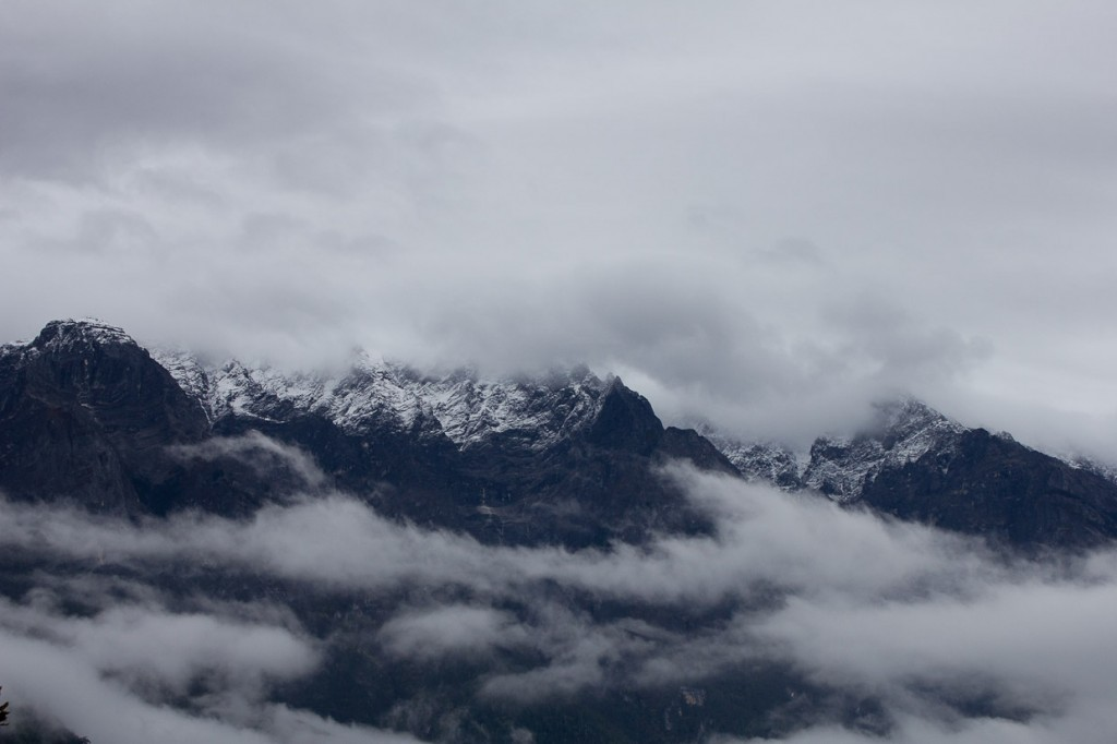 Snow and clouds wreath the peaks of Jade Dragon Snow Mountain in Tiger Leaping Gorge.