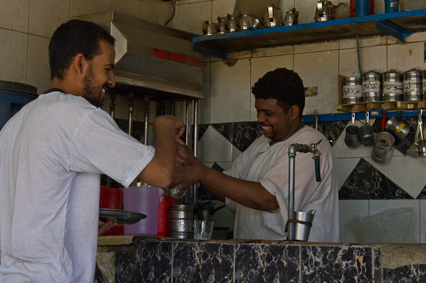 Laughing with the barista in a coffee shop in Daraw, Egypt.