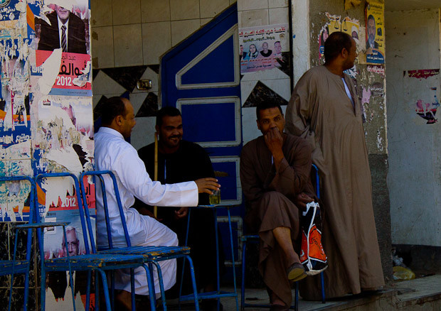 Men lounging outside an ahwa (coffee shop) in Daraw, Egypt.