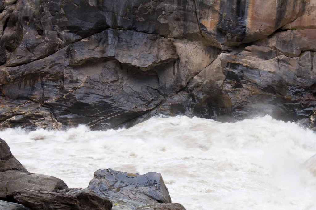 The Yangzi foams at its narrow point in Tiger Leaping Gorge.