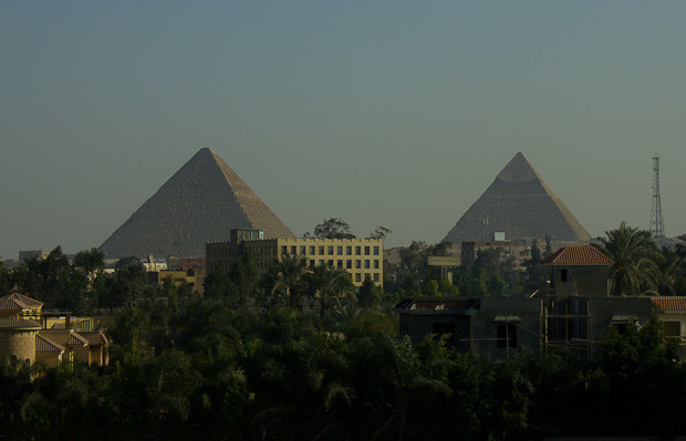 The pyramids of Giza loom out of suburban Cairo.