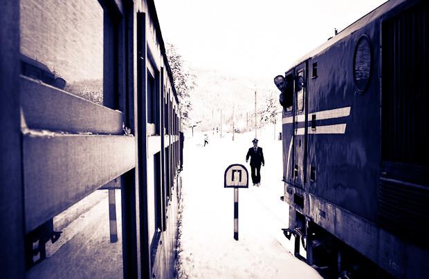 Stationmaster between two trains, on the Septemvri-Dobrinishte line.