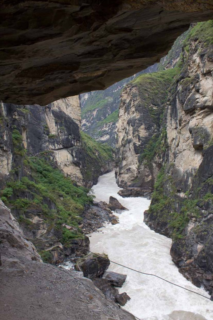 Path in overhanging cliff and Yangzi river - Tiger Leaping Gorge.