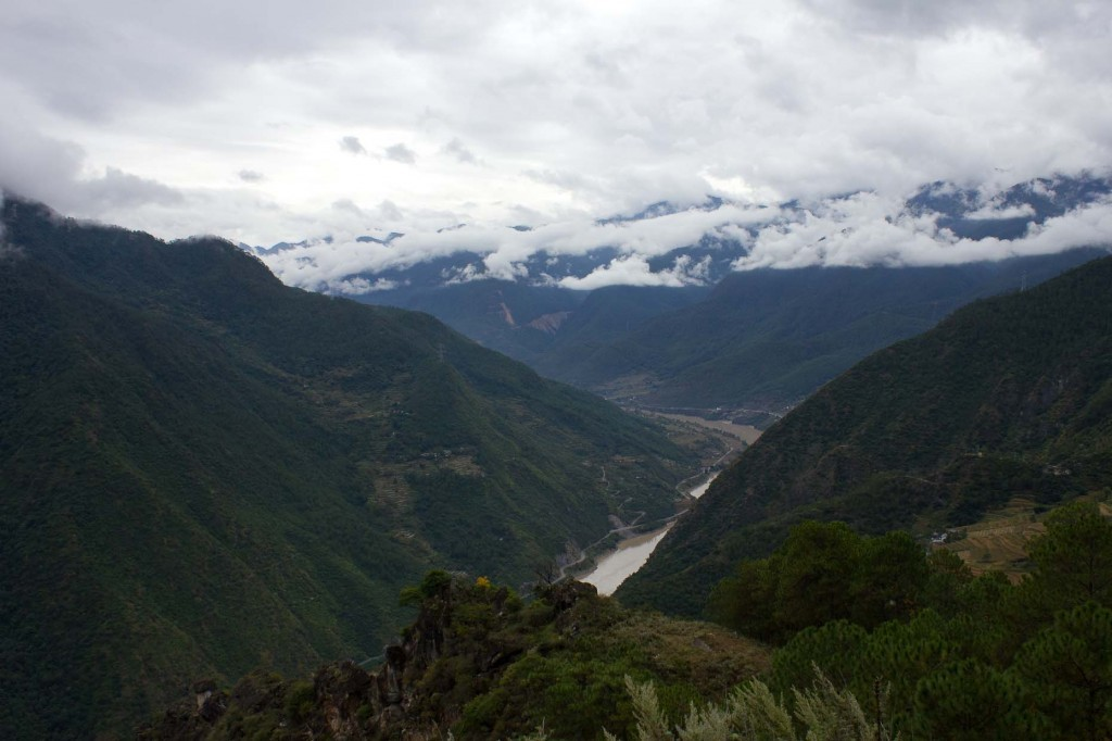 Gentle slopes and a wider Yangzi at the start of Tiger Leaping Gorge.