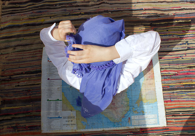 Family travel Egypt: tying an Arab headscarf in the Sinai desert.