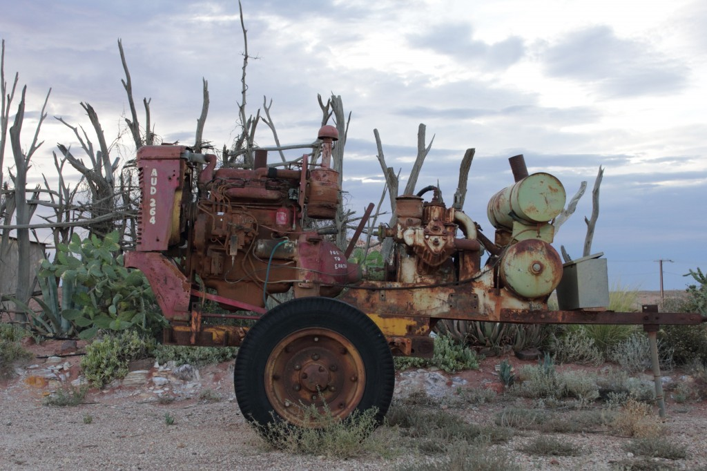mining machinery against dead wood, coober pedy, south australia