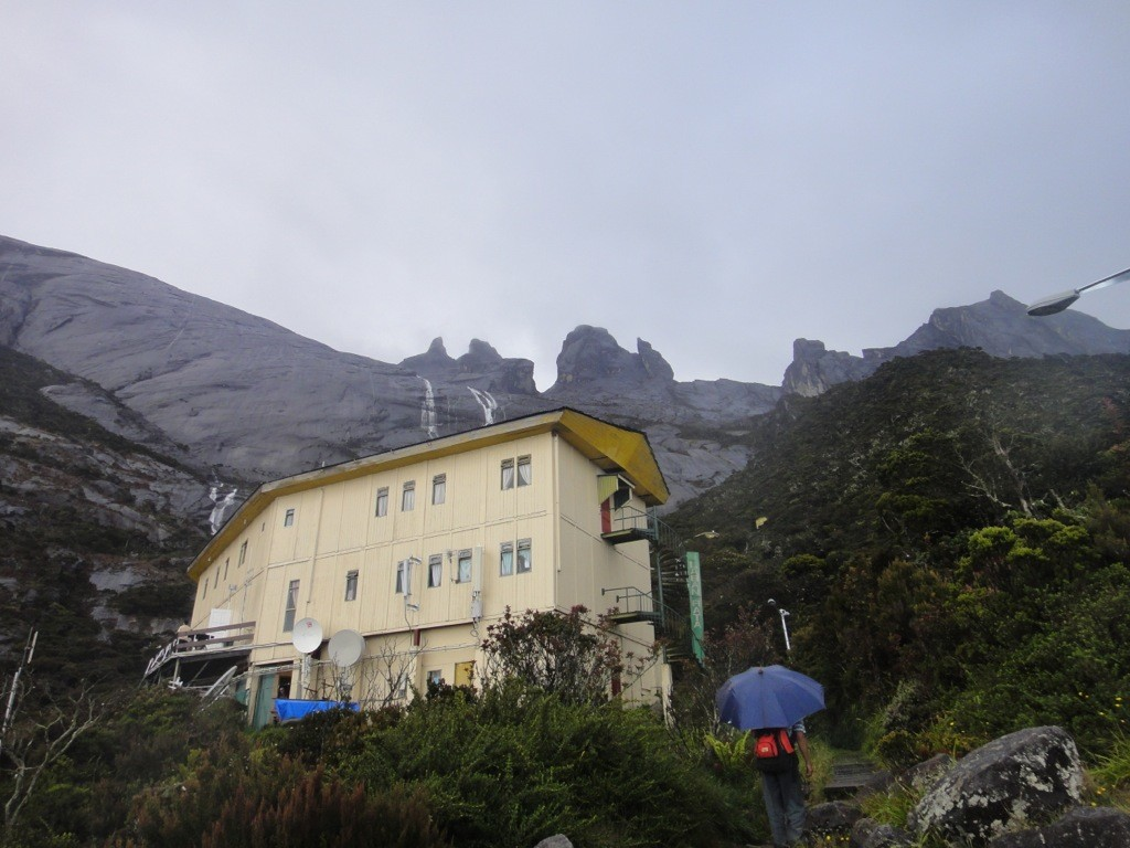 laban rata guesthouse, mount kinabalu, with summit looming behind.