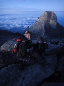 Z and I on top of Mount Kinabalu, with clouds below us and granite peaks behind. Borneo, Malaysia.