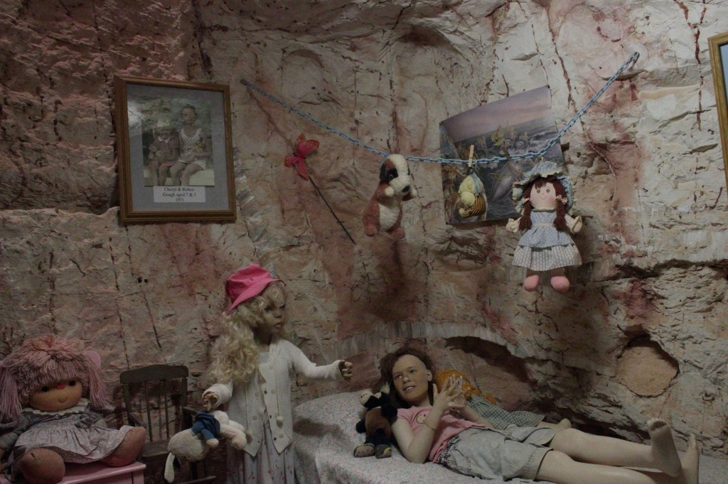plastic models of young girls in 1970s dugout home, coober pedy, south australia
