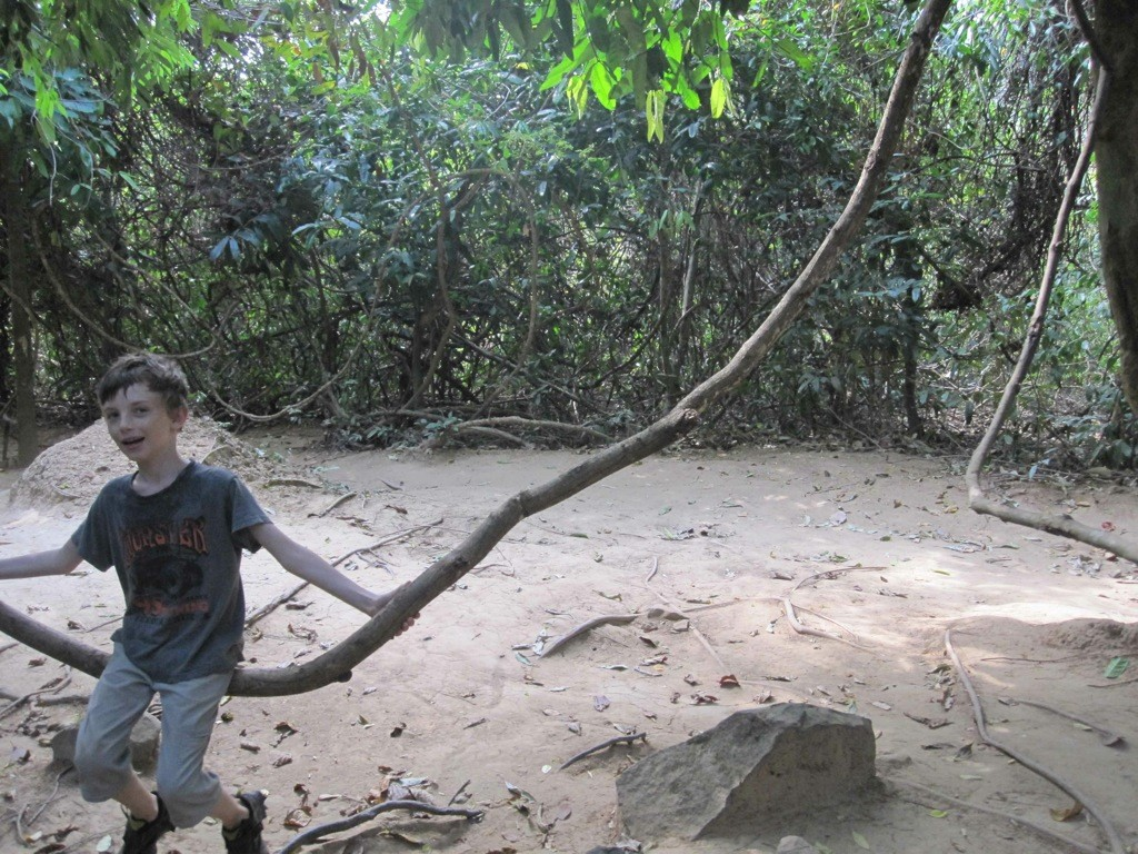 Z enjoying a swing on a jungle vine, Kbal Spean, Cambodia