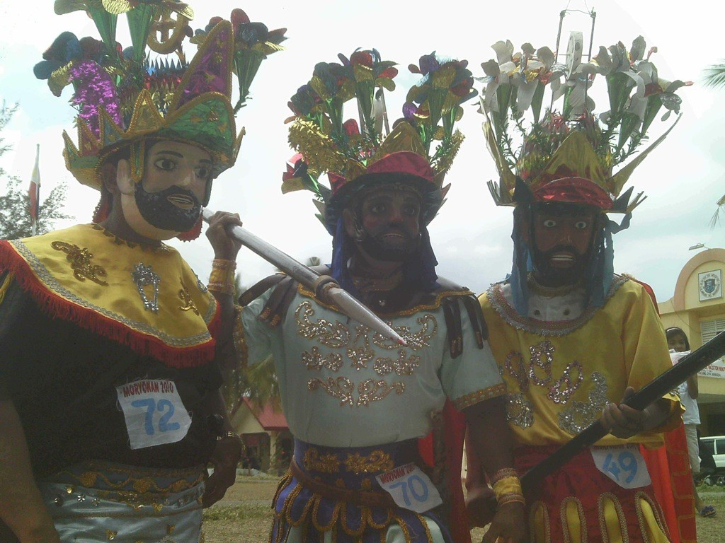 Men in Moriones masks, clad as Roman centurions.