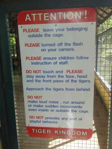 Warning sign on tiger cage, Tiger Kingdom, Chiang Mai, Thailand.