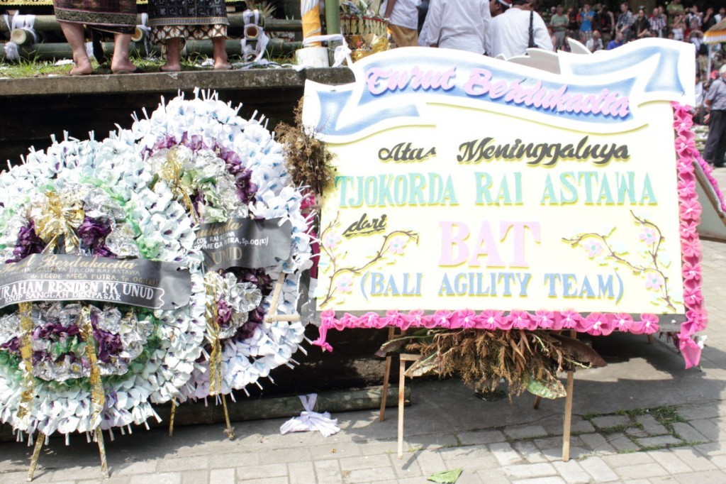 funeral wreaths outside the royal palace ubud: one is from the Bali Agility Team