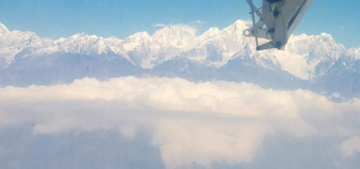 Flying into Lukla - Twin Otter wing over Himalayas.