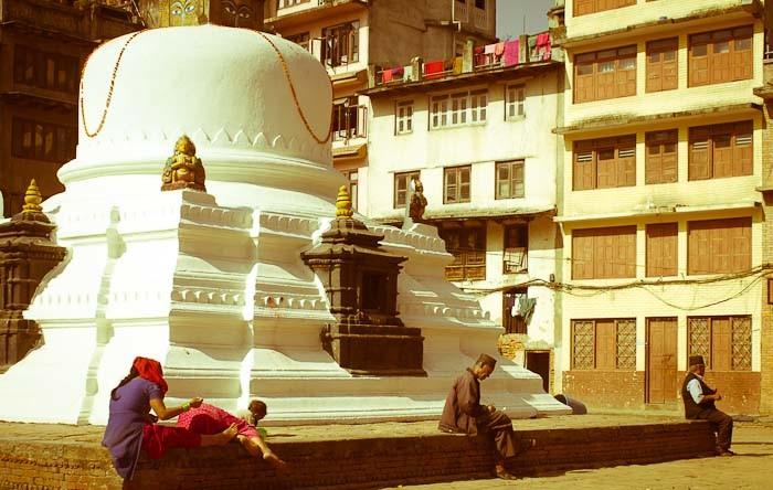 Resting on a stoupa, Kathmandu.