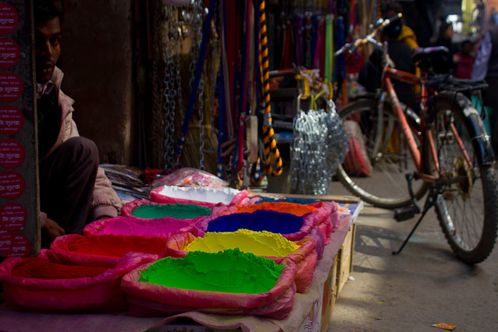Street vendors selling coloured powders, Kathmandu, Nepal.