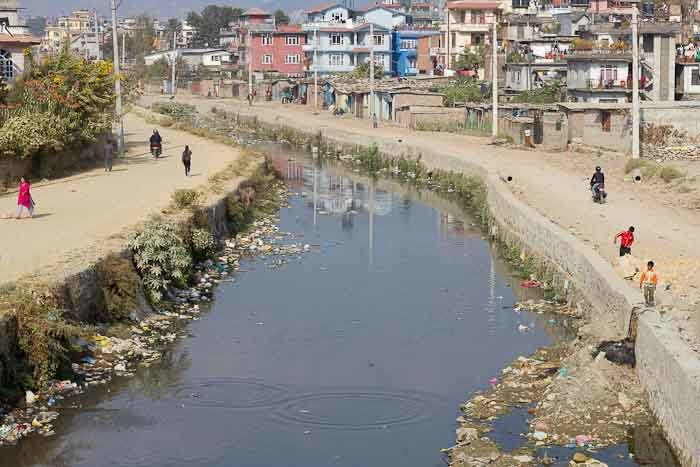 A curve of the Bagmati river in central Kathmandu, Nepal.