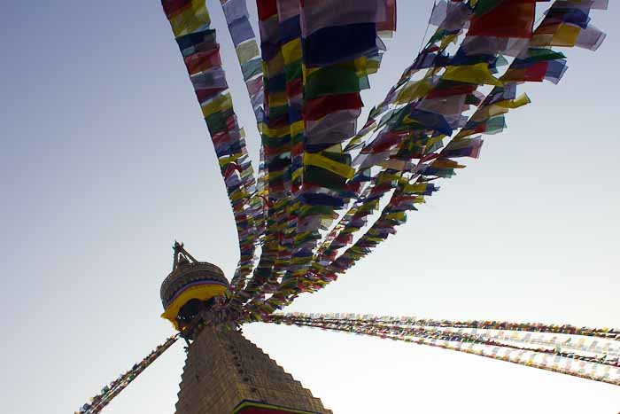 Prayer flags flutter over Bodhnath Stupa, Nepal.
