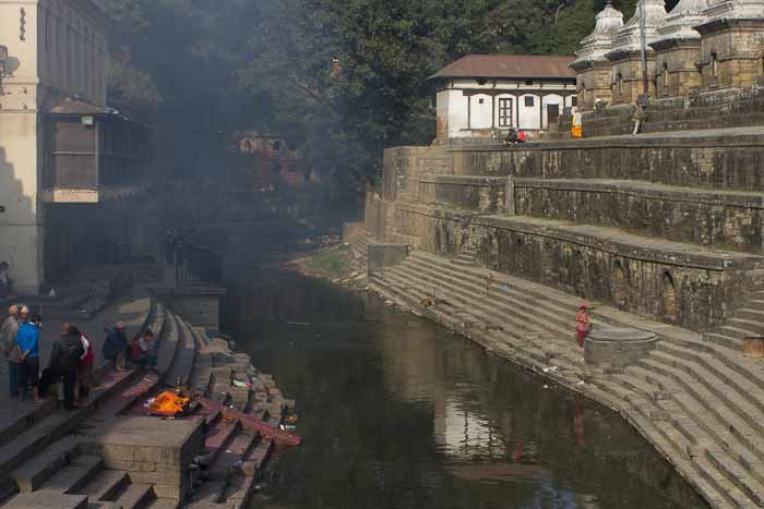 Burning body and body awaiting cremation at Pashupatinath, Nepal.