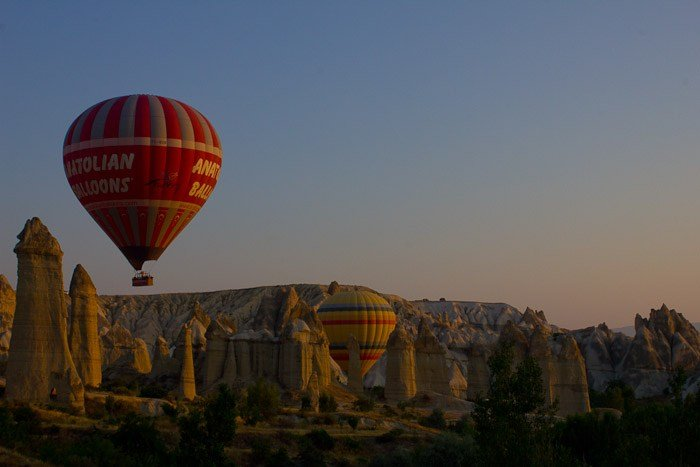 Hot air balloons over Love Valley in Cappadocia, Turkey.