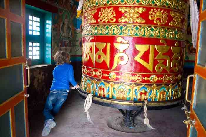 Zac spinning a giant prayer wheel, en route to Everest Base Camp.