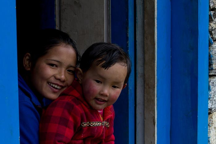Sherpa mother and child saying hello, outside Lukla, on the way to Everest Base Camp.
