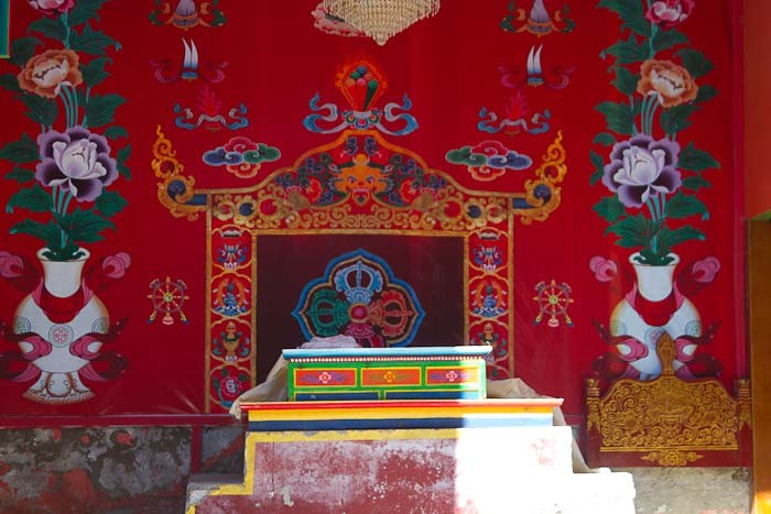 Everest Base Camp: brightly coloured altar at gompa (monastery) in Namche Bazar.