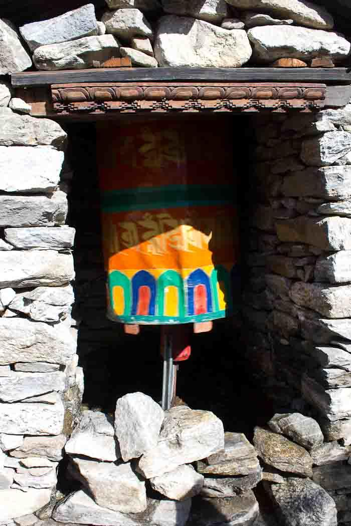 Everest Base Camp: dented water-driven prayer wheel at Thamo, en route to Thame.