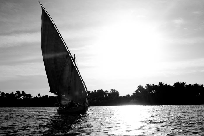 Felucca against sun glare on the Nile.
