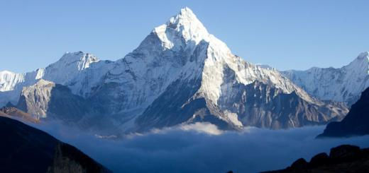 Everest Base Camp trek - Ama Dablam seen from Dzonghla, surrounded by mist.