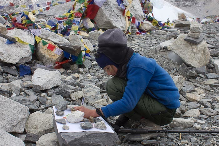 Zac writing his sign in Everest Base Camp.