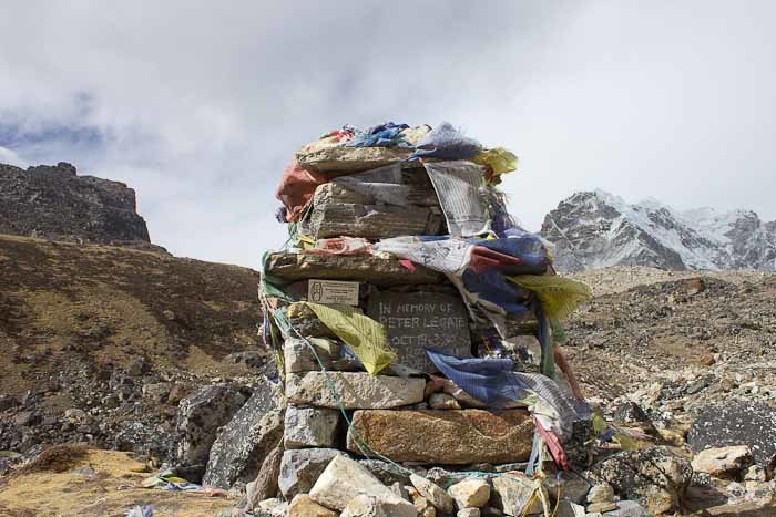 Everest Base Camp trek, memorial cairn  to Peter Legate with fluttering prayer flags.