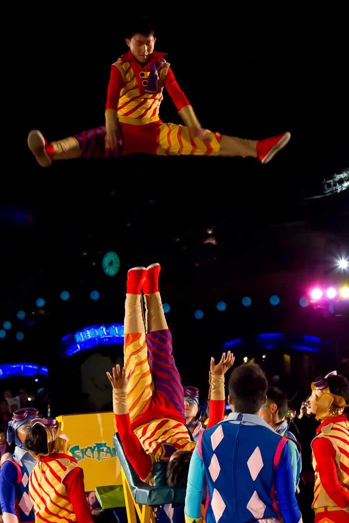 Acrobat performing the splits in mid-air at Ocean Park, Hong Kong.