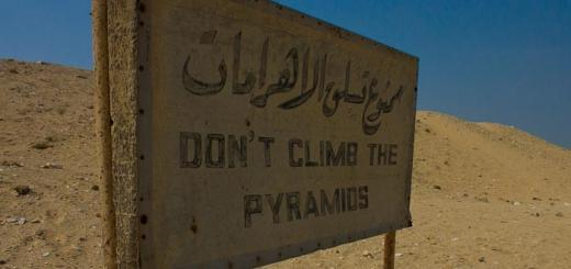 Sign reading - 'Don't climb the pyramids.'