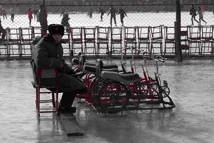 PLA soldier guarding ice bikes.