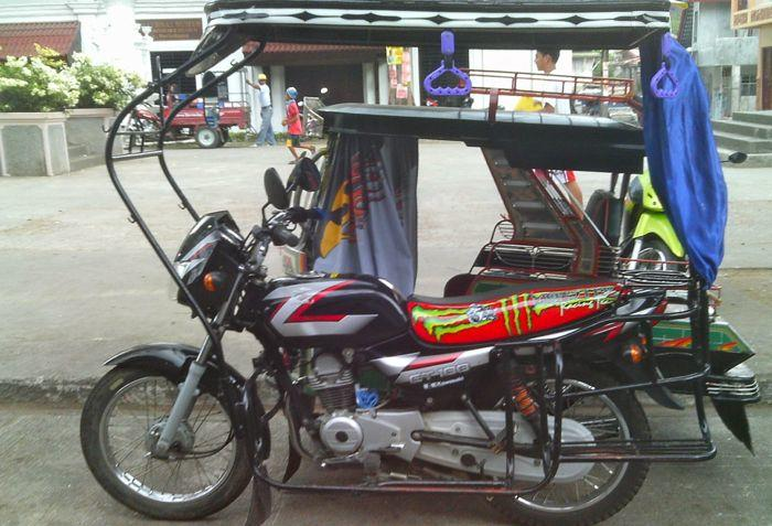 How to earn enough money to travel the world: a tricycle in the Philippines.