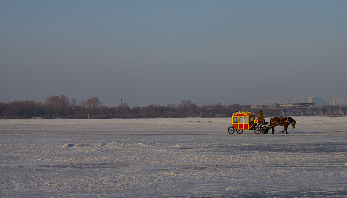 Horse and carriage on the Songhua River, Harbin.